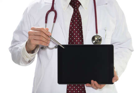 Medical doctor holding tablet facing the front on white background