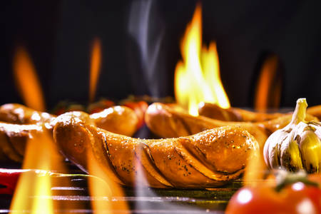 Grilled sausages on the flaming grill Banco de Imagens