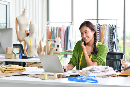 Young Asian woman entrepreneur  fashion designer working in studio
