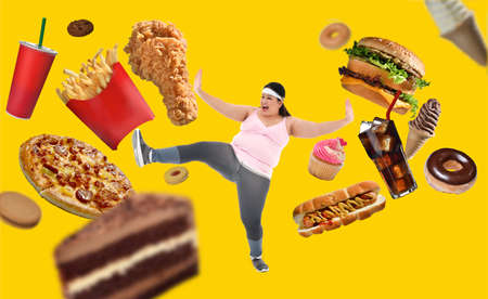 Overweight Asian woman fighting off junk food