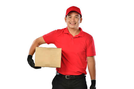 Asian delivery man in red uniform with parcel cardboard box isolated on white background
