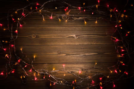 Christmas decoration light on wooden background top view with copy space for frames, presents, and festive Christmas decoration Banque d'images