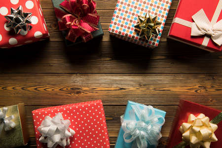 Christmas decoration gift boxes on wooden background top view with copy space for frames, presents, and festive Christmas decoration