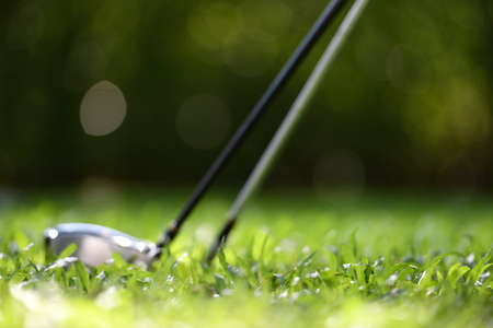 Out focus of golf equipment on golf course background