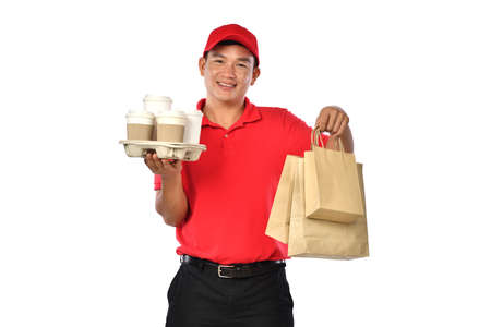 Asian delivery man in red uniform carry bags of food and drink in hands isolated on white background Banque d'images - 157919457