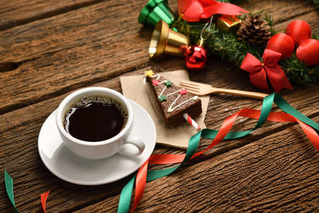 Cup of coffee with Christmas decorations on old wooden table