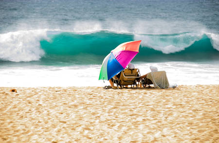 vacationers: Vacationers at the beach watching the aproaching waves