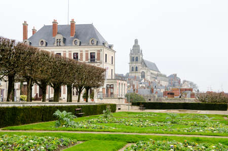 Blois, France - December 20, 2011: Garden at the castle of Blois under an overcast sky