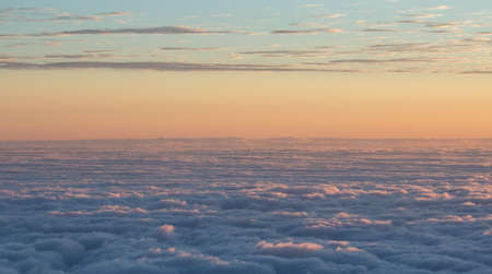 Sea of clouds seen from the top of Haleakala crater at sunrise