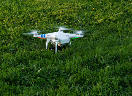 Photo drone on a grassy field ready to take off