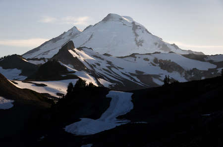 mount baker: Snowy volcano glowing in the light of setting sun