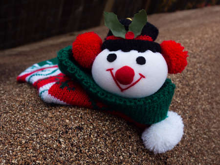 GREEN BUILDINGS: Snowman christmas sock on the rooftop Stock Photo
