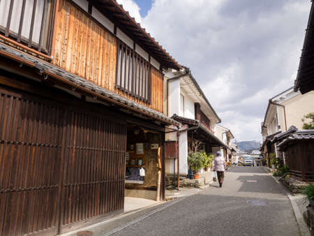 merchant: Uchiko, Japan - March 03, 2013: Sun shining over Edo period traditional merchant houses in historic Uchiko town Editorial