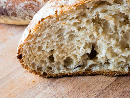 french boule: Cut of a round french boule bread Stock Photo