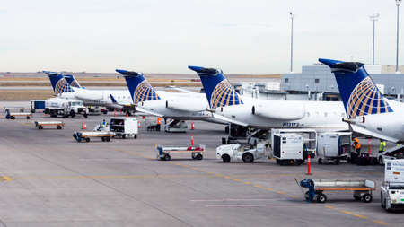 Denver, USA - February 6, 2015: Airplanes boarding at airport terminal