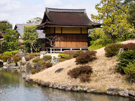 japanese tea garden: Traditional Japanese garden with pond and tea house Stock Photo