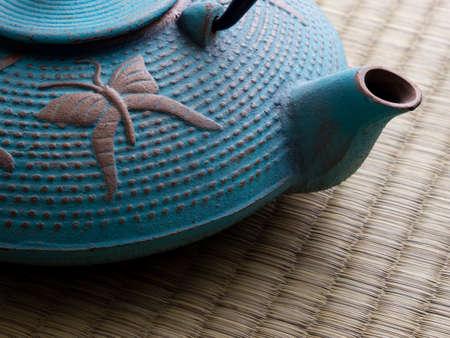 Oriental cast iron tea pot on tatami mat