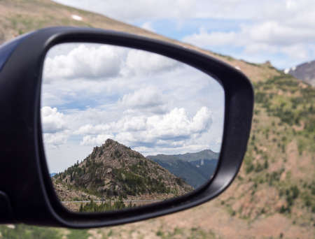 rocky mountain: Mountain scenery reflected in car mirror in Rocky Mountain National Park Stock Photo