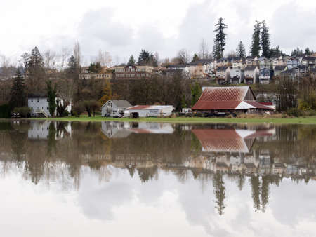 farmlands: Duvall, WA - Nov 18, 2015: Snoqualmie river floods, farmlands and roads under water