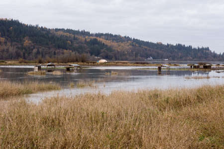 farmlands: Snoqualmie river floods near the city of Duvall, farmlands and roads under water Stock Photo