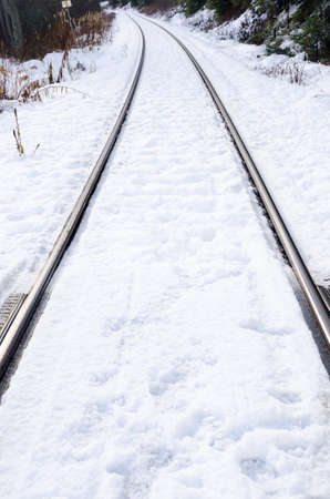 railway transportation: Snow covered railroad tracks