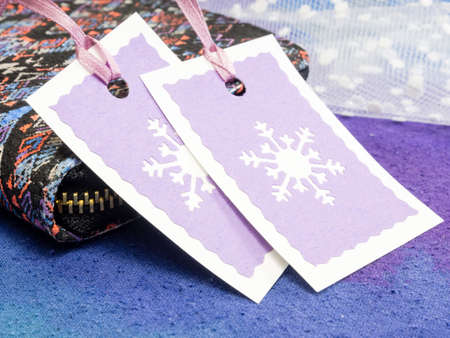 christmas budget: Christmas gift tags with wallet on blue background