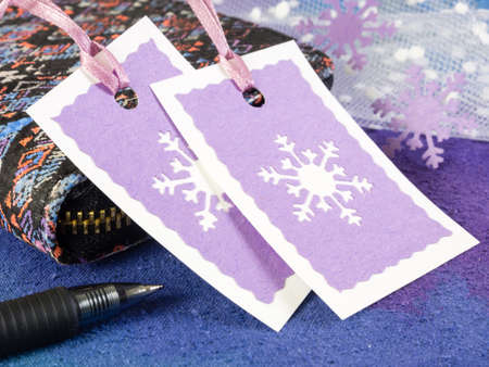 christmas budget: Christmas gift tags with wallet and writing pen Stock Photo
