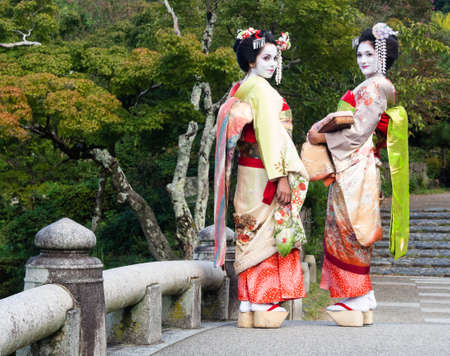 maiko: Kyoto, Japan - September 30, 2015: Western tourists dressed up as maiko in Maruyama park Editorial