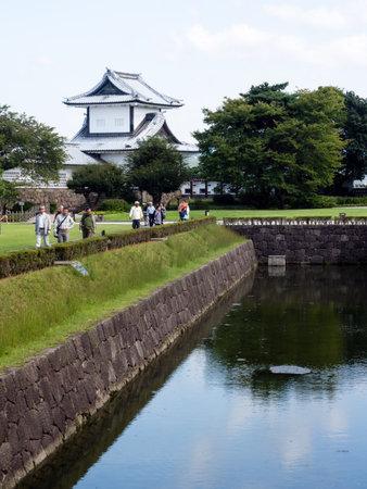 Kanazawa, Japan - September 28, 2015: Tourists walking along the moat of historic Kanazawa castle