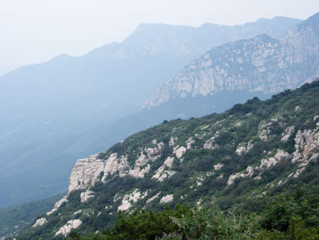 Mist over sacred taoist Songshan mountains in Henan province, China