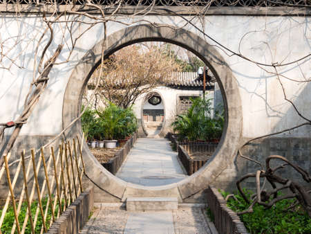 Round gate in classical Chinese garden in Prince Gong Palace, Beijing