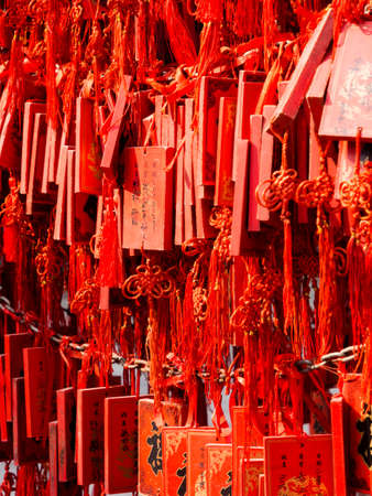 wishing: Red wishing plaques on a tree in a Chinese temple