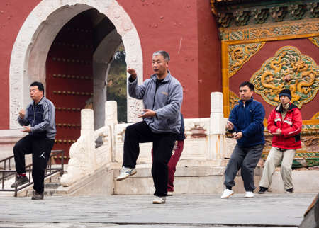 taichi: Beijing, China - March 8, 2015: People practicing Taijichuan in Beihai park on a weekend