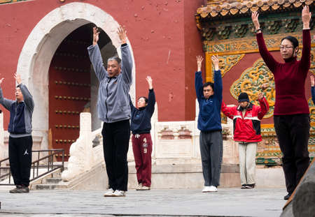 qigong: Beijing, China - March 8, 2015: People practicing Taijichuan in Beihai park on a weekend