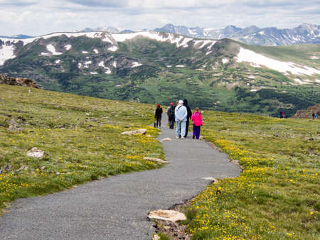 rocky mountain national park: Rocky Mountain National Park, USA - July 14, 2015: Visitors hiking on trail along Trail Ridge road