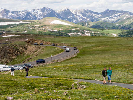 visitors: Rocky Mountain National Park, USA - July 14, 2015: Visitors hiking on trail along Trail Ridge road