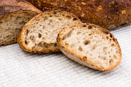 french bread boule: Slices of homemade artisan bread Stock Photo