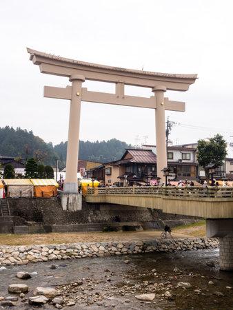 Takayama, Japan - October 10, 2015: Big torii gates of Hachimangu shrine on the day of Takayama Autumn Festival