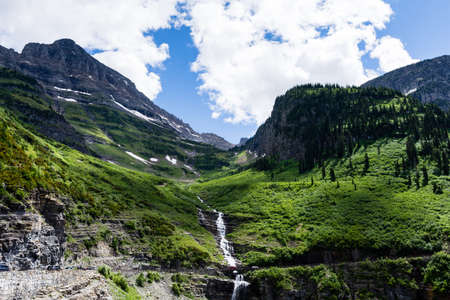 Weeping wall waterfall along Going-to-the-sun road in Glacier National Park, USA Stock Photo