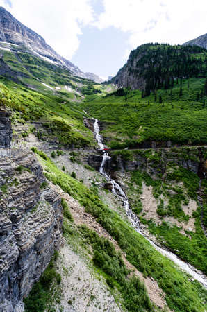 Weeping wall waterfall along Going-to-the-sun road in Glacier National Park, USA Stock fotó