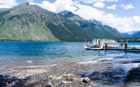Glacier National Park, USA - July 4, 2016: Tourist boat on Lake McDonald in West Glacier waiting for visitors to board