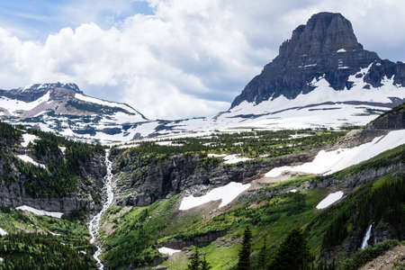 Waterfall under Logan Pass along Going-to-the-Sun Road in Glacier National Park, Montana, USA