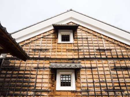 Traditional Japanese house with wooden siding Stock Photo