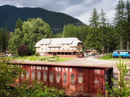 Essex, Montana - July 7, 2016: BNSF train running past historic Izaak Walton Inn near Glacier National Park in Montana