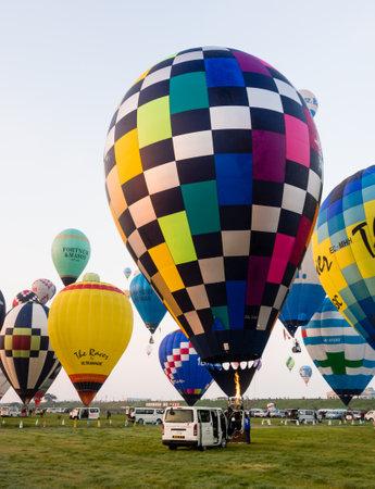 Saga, Japan - November 4, 2016: Hot air balloons inflating and taking off during Saga International Balloon Fiesta Editorial