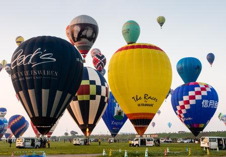 Saga, Japan - November 4, 2016: Hot air balloons inflating and taking off during Saga International Balloon Fiesta 報道画像