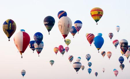 Saga, Japan - November 4, 2016: Dozens of hot air balloons in the sky during early morning competition at Saga International Balloon Fiesta