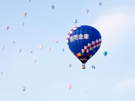 Saga, Japan - November 4, 2016: Colorful hot air balloons flying in the sky during Saga International Balloon Fiesta