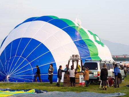 Saga, Japan - November 4, 2016: Hot air balloons inflating and getting ready for take off during Saga International Balloon Fiesta