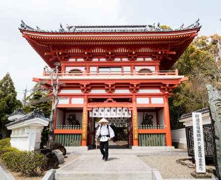 Naruto, Japan - April 2, 2018: Pilgrim at the entrance to Gokurakuji, temple number 2 of Shikoku pilgrimage